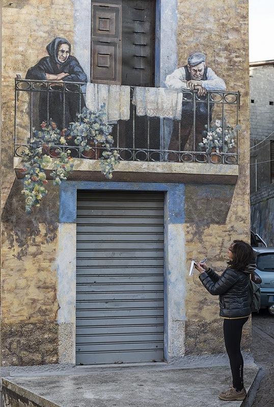 murale orgosolo sardegna in bicicletta